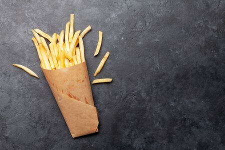 French crispy potato fries. Top view with copy space