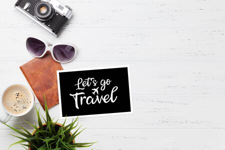 Travel vacation concept with camera, passport and coffee on wooden backdrop. Top view with copy space. Flat lay 写真素材