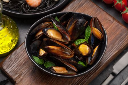 Mussels in tomato sauce and basil leaves and seafood pasta 写真素材