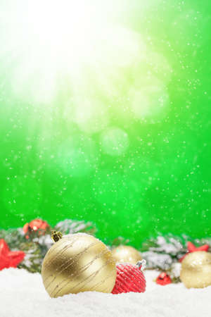 Christmas greeting card with decor in snow over blurred bokeh background and copy space for your xmas greetings