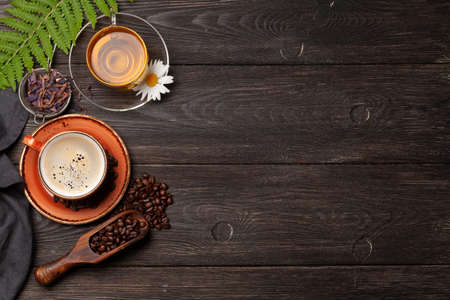 Herbal tea and espresso coffee on wooden table. Top view with copy space. Flat lay Archivio Fotografico