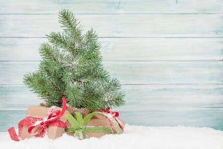 Christmas greeting card with fir tree, gift boxes and copy space for your xmas greetings