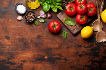 Italian cuisine ingredients. Garden tomatoes, herbs and spices. Top view with copy space. Flat lay