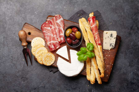 Cheese, meat and olives antipasto. Appetizer selection board. Top view. Flat lay