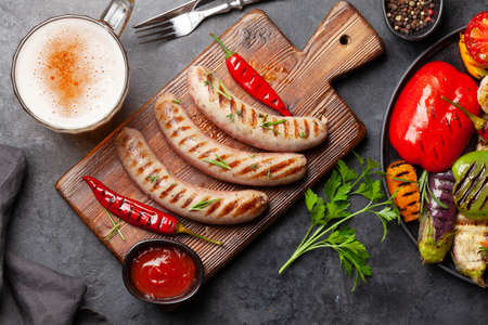 Grilled sausages and vegetables with spices and herbs. Top view flat lay