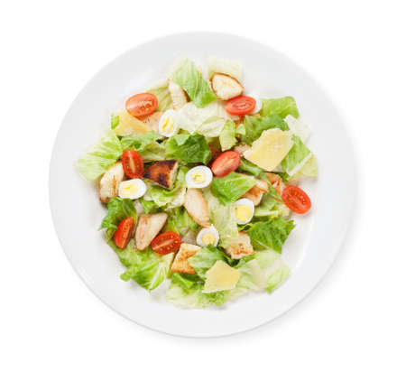 Caesar salad with chicken. Top view flat lay isolated on white