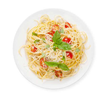 Spaghetti pasta with tomatoes and basil. Top view flat lay isolated on white