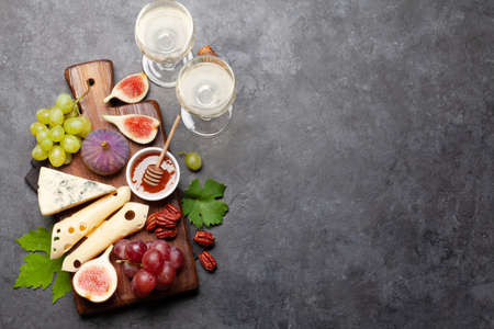 Antipasto plate with cheese, figs and grapes. Appetizer board. Top view flat lay with copy space Zdjęcie Seryjne
