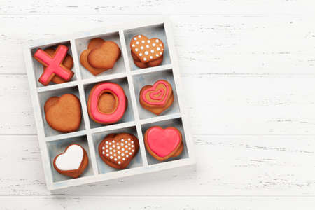 Valentines day concept greeting card with gingerbread cookies in wooden box. Top view flat lay with copy space