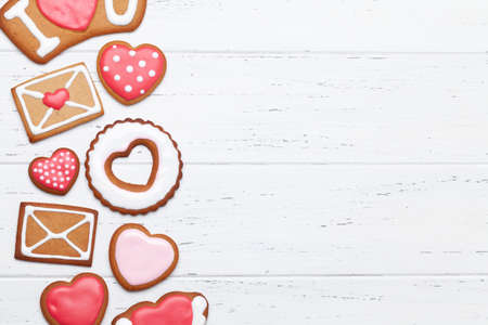 Valentines day greeting card with heart shaped gingerbread cookies. Top view flat lay with copy space