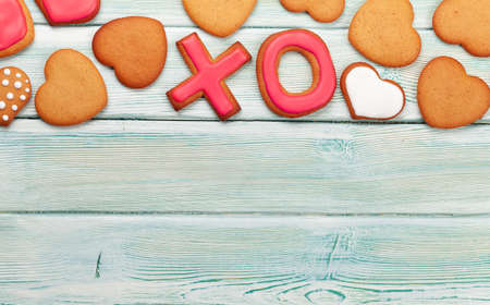 Valentines day concept greeting card with gingerbread cookies. Top view flat lay with copy space