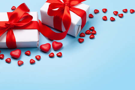 Valentines day greeting card template. Gift boxes, heart candy sweets over blue background. With copy space Imagens - 162298821