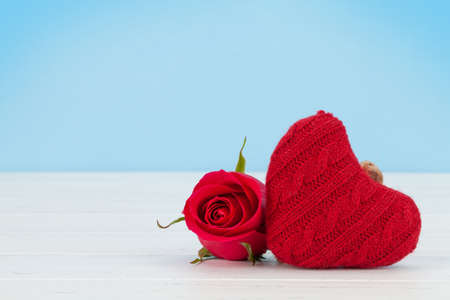Valentines day heart shaped decor and red rose flower on blue background. With copy space Imagens - 162298879
