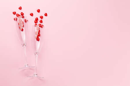 Valentines day card with champagne glasses and heart shaped sweets. Top view flat lay with copy space Imagens - 162298913
