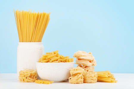 Various types of Italian pasta and copy space