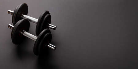Dumbbells. Sport, fitness and healthy lifestyle background. With copy space