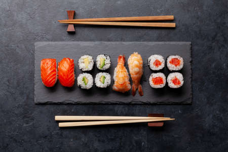 Japanese sushi set on stone plate. Top view flat lay 免版税图像