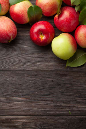 Ripe garden apple fruits on wooden table. Top view flat lay with copy space