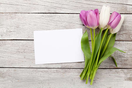 Tulip flowers bouquet. Easter greeting card template. With space for your greetings. Top view flat lay