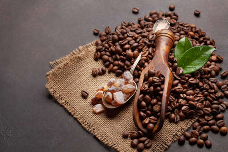 Roasted coffee beans and brown sugar. With copy space