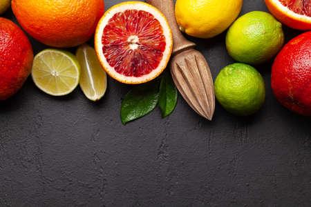 Various fresh citrus fruits. Bood orange, lime, lemon. Top view flat lay with copy space