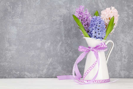 Hyacinth flowers bouquet on wooden table. Easter greeting card template. With space for your greetings