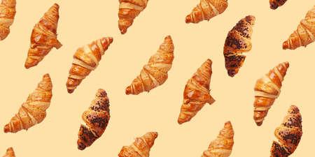 Fresh tasty croissants seamless texture. Breakfast meal. Top view flat lay Standard-Bild