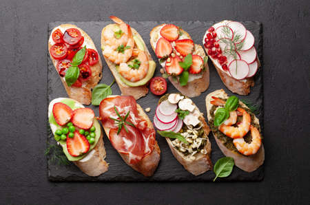 Appetizers plate with traditional spanish tapas set. Italian antipasti brushetta snacks. Top view flat lay