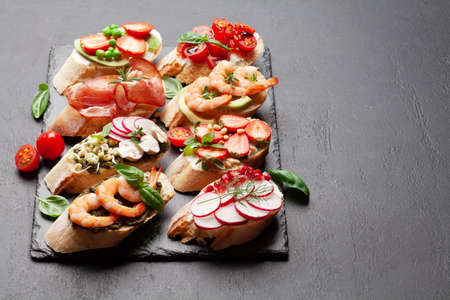 Appetizers plate with traditional spanish tapas set. Italian antipasti brushetta snacks. With copy space