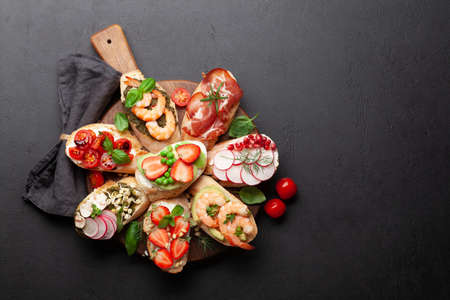 Appetizers plate with traditional spanish tapas set. Italian antipasti brushetta snacks. Top view flat lay with copy space Standard-Bild