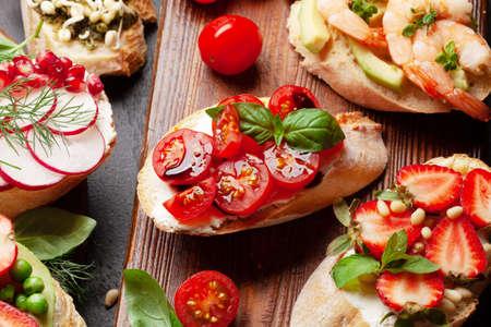 Appetizers board with traditional spanish tapas set. Italian antipasti bruschetta snacks