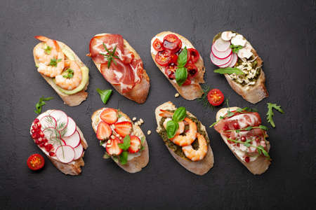 Appetizers board with traditional spanish tapas set. Italian antipasti bruschetta snacks. Top view flat lay