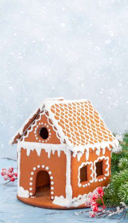 Christmas greeting card with gingerbread house and fir tree. With copy space for your greetings