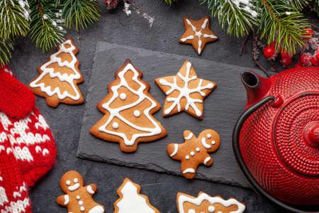 Christmas card with gingerbread cookies, tea and fir tree. Top view flat lay Фото со стока