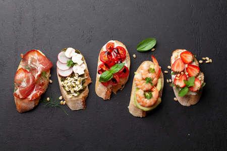 Appetizers board with traditional spanish tapas set. Italian antipasti brushetta snacks. Top view flat lay