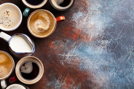Many cups of coffee on stone table. Top view flat lay with copy space Фото со стока