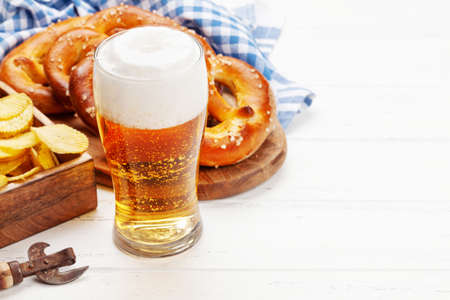 Lager beer mug and fresh baked homemade pretzel with sea salt. Classic beer snack. With copy space Фото со стока