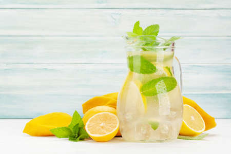 Fresh homemade lemonade with lemon and mint. With copy space