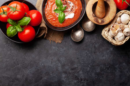 Homemade cooking cold gazpacho soup with fresh garden tomatoes. Top view flat lay with copy space