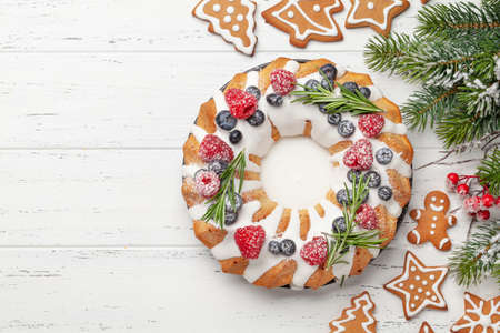 Christmas cake with berries and gingerbread cookies. Top view flat lay with space for your greetings