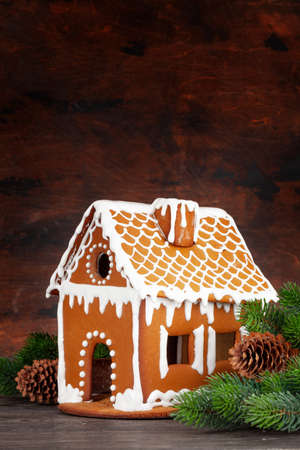 Christmas greeting card with gingerbread house, fir tree and copy space