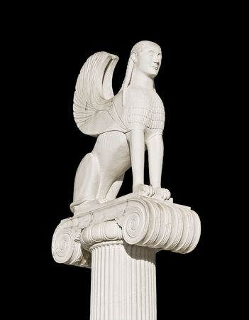 Large ancient Greek sphinx statue fixed on an ionic pillar capital Stock Photo