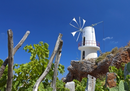 Traditional windmill at Lasithi plateau at Crete island photo