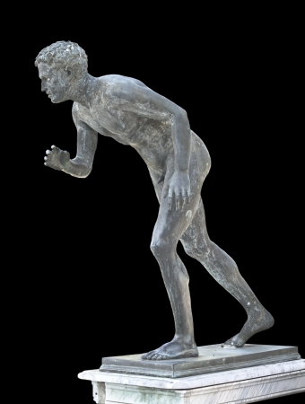 Classic ancient statue showing an olympic runner photo