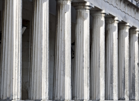 Row of Ancient Greek temple pillars photo
