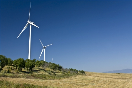Electric power wind generators stationed on a hill  photo