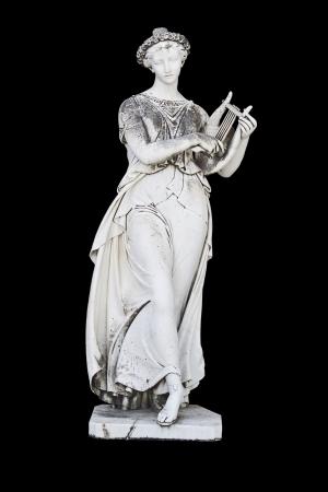 arpa: Antigua estatua griega que muestra una musa m�tica