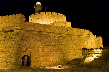 Fortress at the harbor of Rhodes island in Greece photo