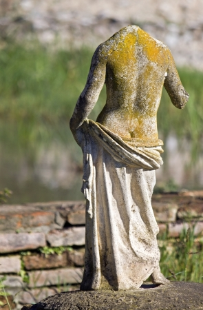 naked statue: Greek archaic statue at ancient Dion in Greece Stock Photo