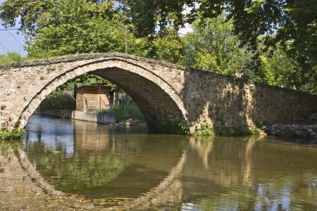 Old stone footbridge at Edessa city in Greece Stock Photo - 16040286